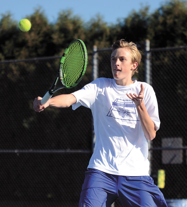 T-R PHOTO BY STEPHEN KOENIGSFELD • Freshman Jack Gruening returns a volley against Fort Dodge's Mitchell Emery in their singles match Thursday at Marshalltown High School. Gruening lost in a close two-set contest, 6-3, 7-6, but the Bobcats won as a team 7-4.