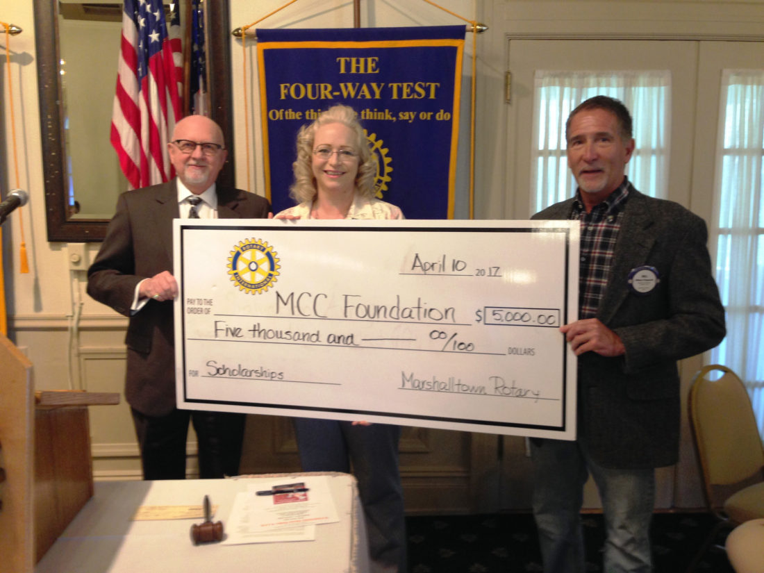 CONTRIBUTED PHOTO Rotarians Vic Helberg and Bill Fitzgerald demonstrate the club's continued support of Marshalltown Community College scholarships. MCC Foundation Director Carol Geil was on hand at this week's luncheon to accept the donation.