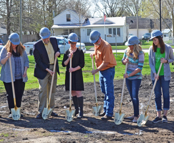 Monday morning, work on the Gutekunst Public Library's expansion project began. A public groundbreaking ceremony was held with the library's director Mara Edler (center), State Center Mayor Harlan Quick (center left), and library board members. The 4,300 square foot library, the former home of John and Angie Gutekunst, will double in size when the new building is added on to the existing structure.
