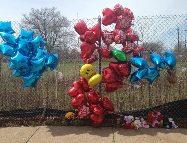 AP PHOTO A makeshift memorial sits along a fence Monday, near where Robert Godwin Sr., was killed in Cleveland. Police said Steve Stephens killed Godwin on Sunday and posted the video on Facebook.