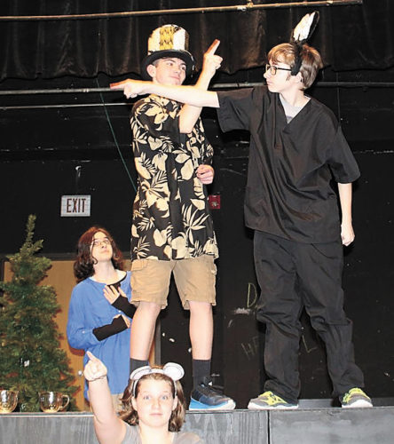 """CONTRIBUTED PHOTO Characters get their directions messed up during rehearsal for the spring play """"Alice"""" at Miller Middle School. The play will be held at 7 p.m. on April 20 in the Miller Auditorium. Pictured front row, Breanna Hovey; second row, Savanna Calkins, Jesse DeMeyer and Sam Wilder."""