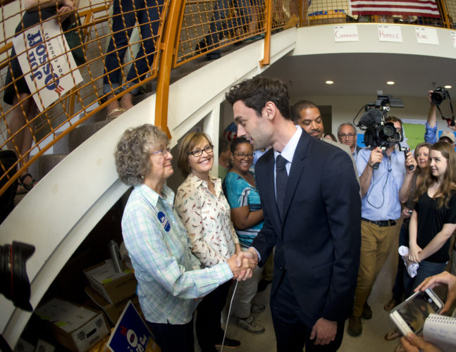 AP PHOTO Democratic candidate for Georgia's Sixth Congressional seat Jon Ossoff greets supporters at a campaign field office Tuesday, in Marietta.