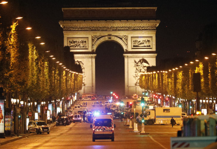AP PHOTO Police forces take positions on the Champs Elysees avenue in Paris, France, after a fatal shooting in which a police officer was killed along with an attacker, Thursday.