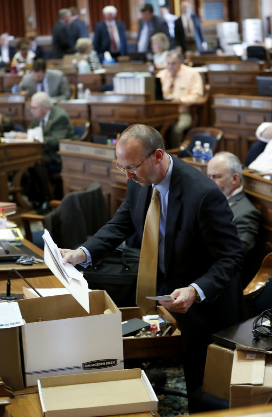 AP PHOTO Rep. Chip Baltimore, R-Boone, loads a box at his desk in the Iowa House, Friday, at the Statehouse in Des Moines.