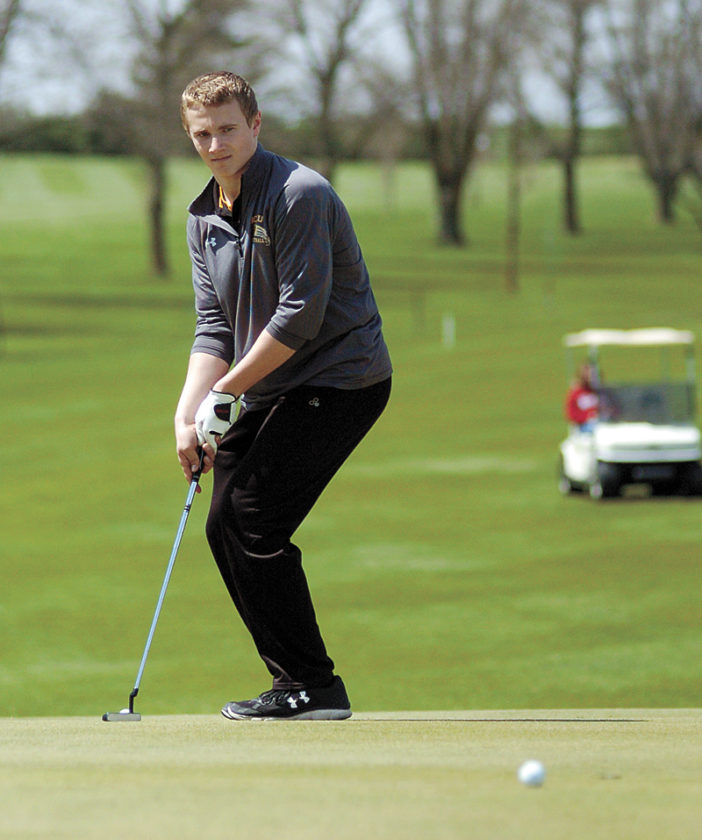 T-R PHOTO BY ROSS THEDE • BCLUW's Brad Barkema tries to coax his par putt into the cup on the ninth green during the final round of Saturday's Spartan Invite at Town & Country Golf Club in Grundy Center. Barkema led the Comets to a third-place team finish with his fifth-place round of 84.