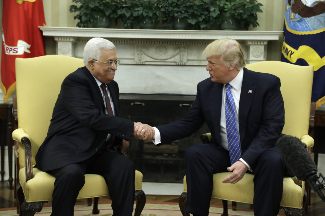 AP PHOTO President Donald Trump shakes hands with Palestinian leader Mahmoud Abbas during their meeting in the Oval Office of the White House, Wednesday, in Washington.