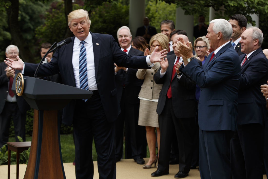 AP PHOTO President Donald Trump, accompanied by GOP House members, speaks in the Rose Garden of the White House in Washington, Thursday, after the House pushed through a health care bill.
