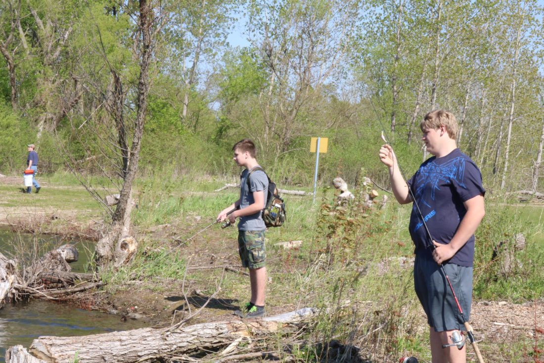 T-R PHOTO BY ADAM SODDERS Juniors Zach Edel, front, and Connor Bulanek, went after Sand Lake's rainbow trout during the club's second outing Friday afternoon.