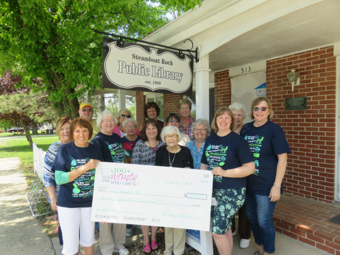 CONTRIBUTED PHOTO A group from 100+ Women Who Care Hardin County presented a check to Sandy Trampe in the amount of $7,300 for support of the Steamboat Rock Library renovation project.