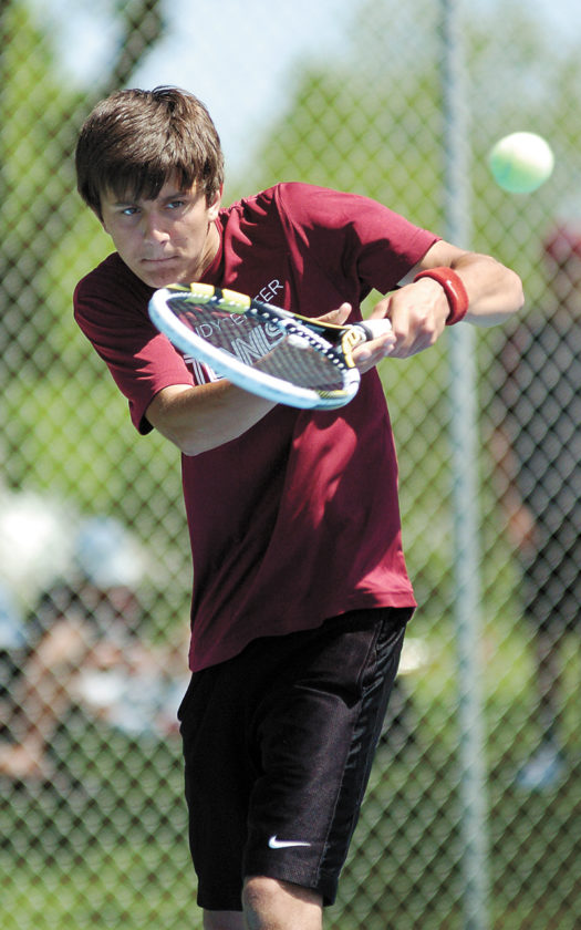 T-R PHOTO BY ROSS THEDE • GC/G-R junior Tjaden Meester makes a backhand return during singles play at Saturday's preliminary substate dual meet against North Polk.