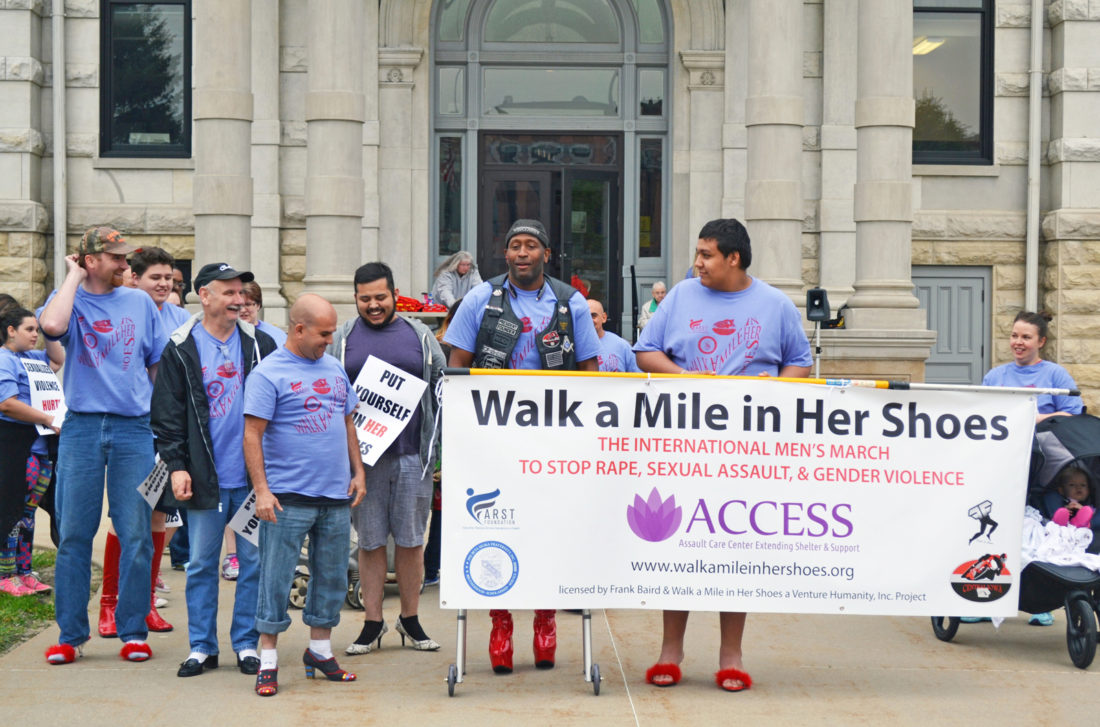 T-R FILE PHOTO The annual Walk a Mile in Her Shoes walk around downtown Marshalltown will be held Saturday, May 20 at the Courthouse Lawn. Registration and a White Ribbon Campaign ceremony will begin at 4 p.m., with the walk starting at 6 p.m. Men are asked to wear high-heeled shoes for the walk. Money raised benefits ACCESS.