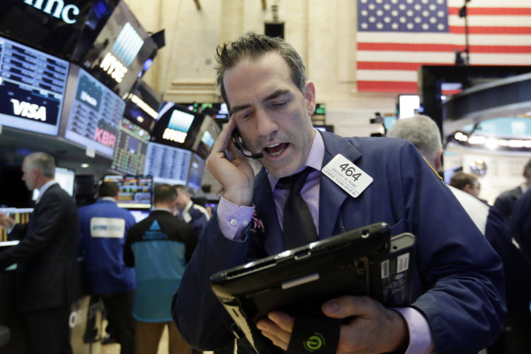 AP PHOTO Trader Gregory Rowe works on the floor of the New York Stock Exchange, Wednesday. Stocks are opening lower on Wall Street as banks and industrial companies fall.