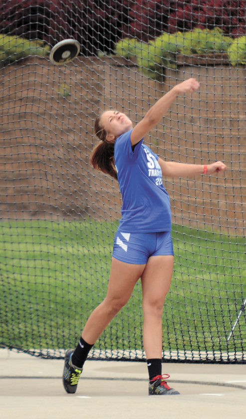 T-R PHOTO BY STEPHEN KOENIGSEFLD • Marshalltown's  Malory Henze warms up in the discus ring on Thursday, prior to the event at the Class 4A state track and field meet at Drake Stadium in Des Moines. Henze was 10th with a final throw of 116 feet, 4 inches.