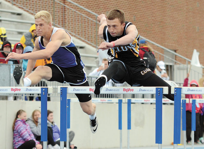 T-R PHOTO BY STEPHEN KOENIGSFELD • BCLUW's Jack Garber, center, jumps over one of the beginning hurdles during the 110-meter hurdles Friday in the Class 2A state track and field meet. Garber is seeded fifth for today's finals, after running a 15.22 preliminary race.