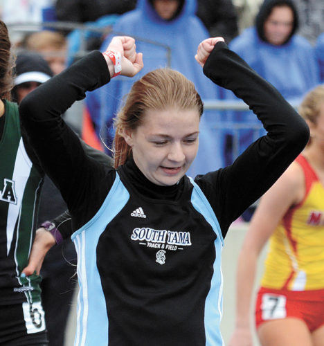 T-R PHOTO BY STEPHEN KOENIGSFELD • South Tama County's Allison Yuska reacts to seeing her time of 1 minute, 5.03 seconds after the 400-meter hurdles on Friday. Yuska's goal was to run a 1:05-minute 400-hurdle time, and she was the state runner-up in the event.