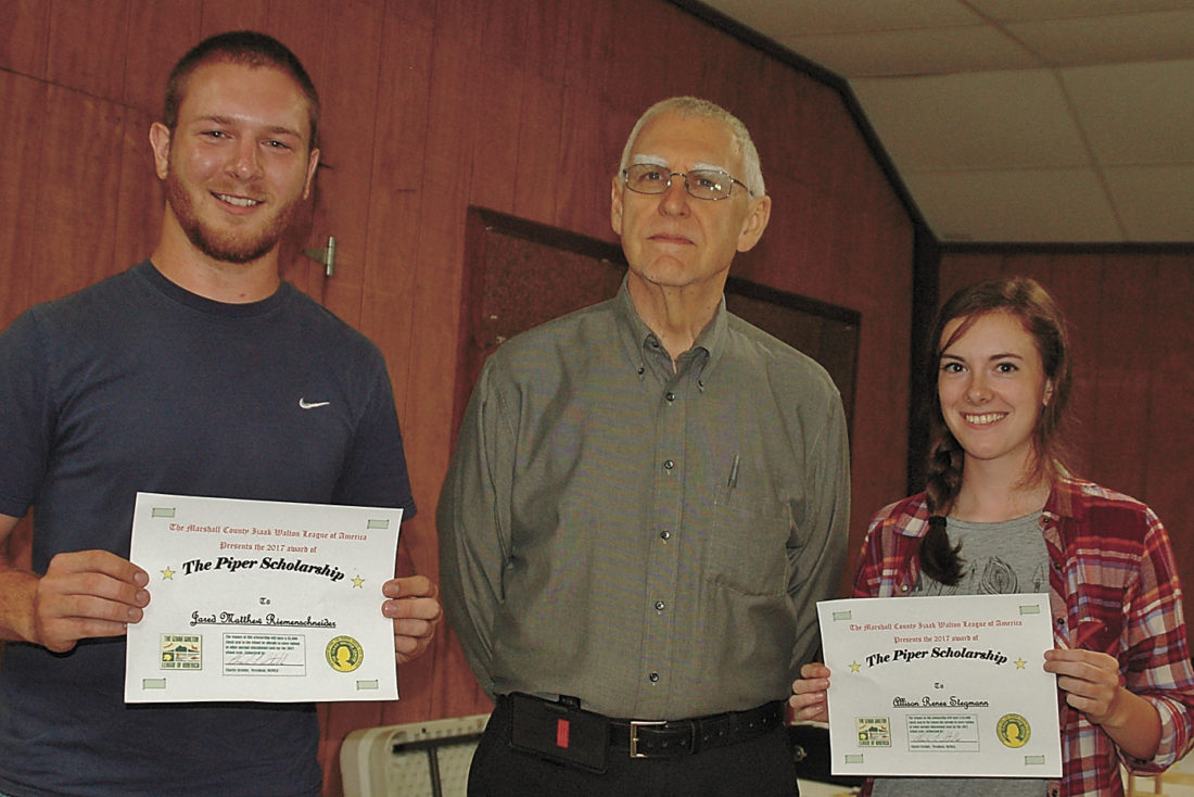 CONTRIBUTED PHOTO by Garry Brandenburg The Izaak Walton League, Marshall County Chapter, announces the award of two scholarships to area students. At left is Jared Matthew Riemenschneider, center is Ikes President Charles Strobbe and Allison Renee Stegmann.