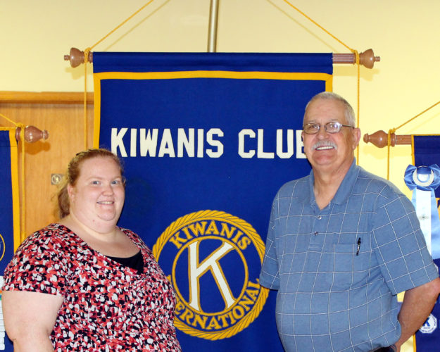 CONTRIBUTED PHOTO Mike Gowdy welcomes Jennifer Hart, recreation director of Marshalltown Park & Rec, to the Noon Kiwanis Club as she laid out summer family-friendly activities.