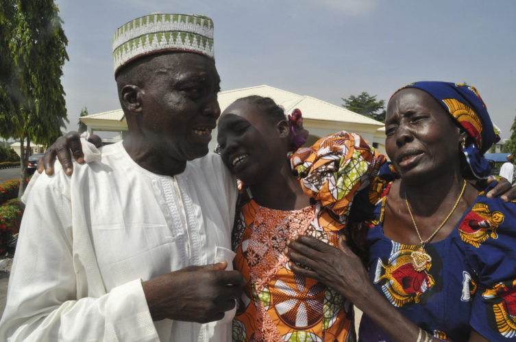 AP PHOTO Family members celebrate as they embrace a relative, one of the released kidnapped schoolgirls, in Abuja, Nigeria, Saturday.