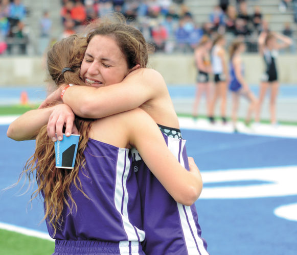 T-R PHOTO BY STEPHEN KOENIGSFELD • AGWSR distance runners Aubrie Fisher, right, and Bethany Lippert embrace after Saturday's Class 1A 1,500-meter run at the state meet in Des Moines. Fisher, a sophomore, finished second in 4 minutes, 55.77 seconds, while the senior Lippert also medaled with an eighth-place finish in 4:59.93.