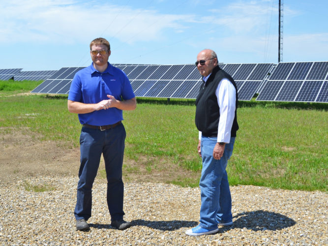 T-R PHOTO BY SARA JORDAN-HEINTZ CIPCO Manager of Engineering Terry Fett and CEO Dennis Murdock discussed the benefits of solar power during the unveiling Thursday afternoon at the Marshalltown Gateway Centre Solar Array Site.