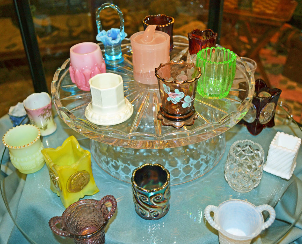 T-R PHOTO BY SARA JORDAN-HEINTZ The Marshalltown Early American Glass Club was gifted 38 toothpick holders from the personal collection of the late Nadine Collins. The items will be on permanent display at the Historical Society of Marshall County's Museum, housed with other glass club pieces. The toothpick holders date from the late 1870s to early 20th century.