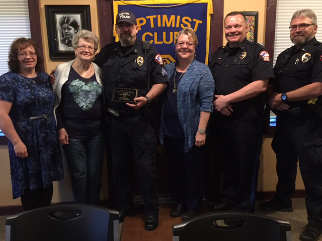 CONTRIBUTED PHOTO Sgt. Rick Lang, of the Marshalltown Police Department, third from left, accepts the Ron Galloway Respect for Law Award from the Marshalltown Morning Optimist Club at a recent club meeting. Also present at the presentation were, left to right, Teresa Lang, Carol Lang, Sgt. Lang, Cindy Egleston, Chief Michael Tupper and Lt. Ron Ohrt. The annual award was named for Capt. Ron Galloway, deceased member of the Marshalltown Police Department and the Morning Optimist Club.