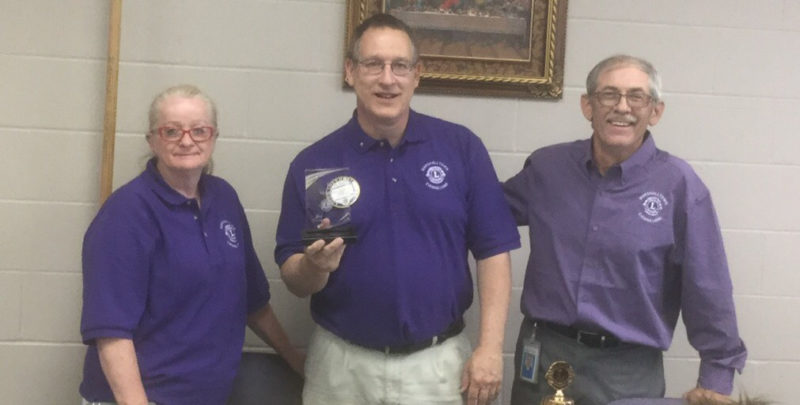"CONTRIBUTED PHOTO District Governor Elect Judy Stone and Tail Twister Kevin Lageschulte present Tim Fienup with the Evening Lions ""Lion of the Year"" award."