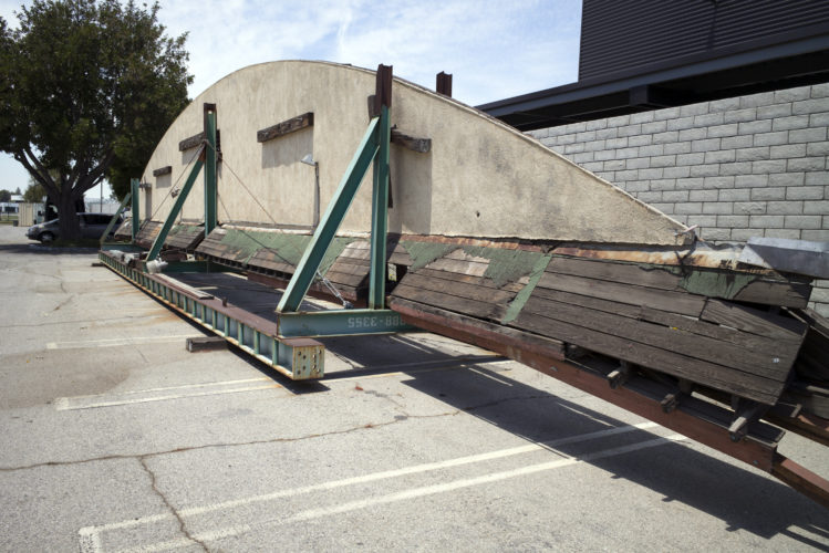 """This May 23, 2017, photo shows part of the disassembled hangar facade that framed the opening scene of the 1942 film """"Casablanca,"""" where it is stored in a parking lot at Van Nuys Airport in Los Angeles' San Fernando Valley. Christine Dunn, who with her late husband recovered the hangar 10 years ago, told the Daily News on Sunday, May 28, that it'll be moved to Valley Relics Museum, home to many pop culture items. (David Crane/Los Angeles Daily News via AP)"""