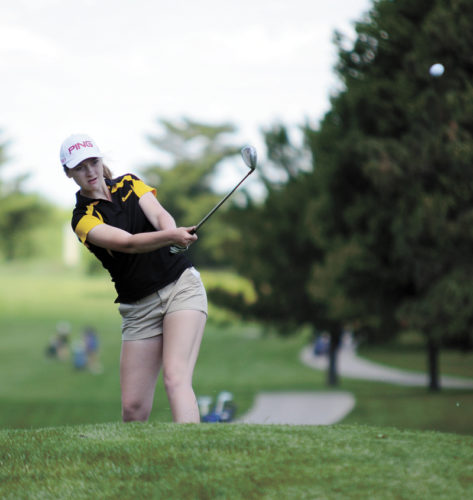 T-R PHOTO BY STEPHEN KOENIGSFELD • BCLUW's Katie Garber chips onto the green on Hole 6 at Jester Park Golf Course on Tuesday during the first round of the Class 2A golf tournament near Granger. The Comets are in seventh place with a 397 team total after the first day.