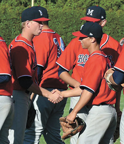 T-R PHOTO BY ANNE VANCE • Marshalltown junior pitcher Nate Vance, right, is congratulated by teammates after throwing a shutout against Fort Dodge in the first game of Tuesday's CIML Iowa Conference twinbill in Fort Dodge. Vance struck out six, walked one and helped MHS prevail 5-0 in the first game.