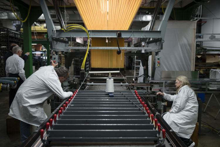 AP PHOTO In this March 23, file photo, workers manufacture thermal protection systems for NASA at Bally Ribbon Mills in Bally, Pa. U.S. employers pulled back on hiring in May 2017 by adding only 138,000 jobs. Hiring was still enough to help keep pushing unemployment lower.