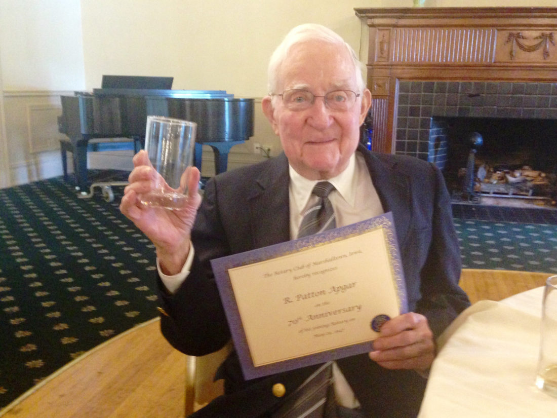 CONTRIBUTED PHOTO Rotary members helped Pat Apgar celebrate his 70th anniversary of membership this week. Apgar is holding the glass he joked about returning to Elmwood. He told the story of having it in hand during a fire evacuation at a meeting years ago.