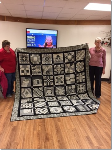 CONTRIBUTED PHOTO Rosanne Anderson, Guild president, and Dorothy Faidley, superintendent of Fabric and Threads, show the 2017 State Fair raffle quilt at the May meeting of the Central Iowa Quilt Sew-ciety.