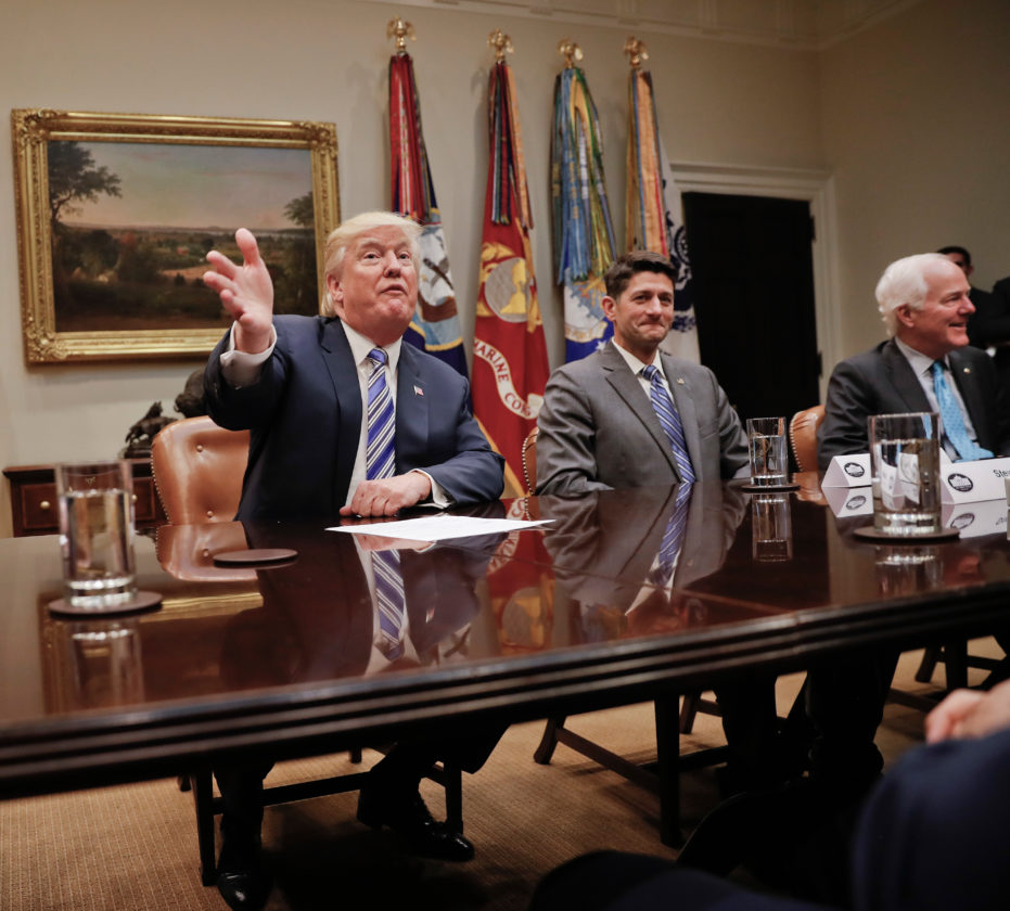 AP PHOTO President Donald Trump, left, gestures during a meeting with House and Senate Leadership in the Roosevelt Room of the White House in Washington, Tuesday. With Trump are House Speaker Paul Ryan of Wis. (center), and Senate Majority Whip John Cornyn of Texas. Senate Majority Leader Mitch McConnell of Ky., is to Trump's left, unseen.