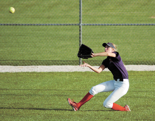 T-R PHOTO BY ROSS THEDE • Marshalltown center fielder Ciara Feldman makes a sliding catch during the first game of Wednesday's CIML Iowa Conference doubleheader against Class 5A No. 5 Urbandale at MHS.