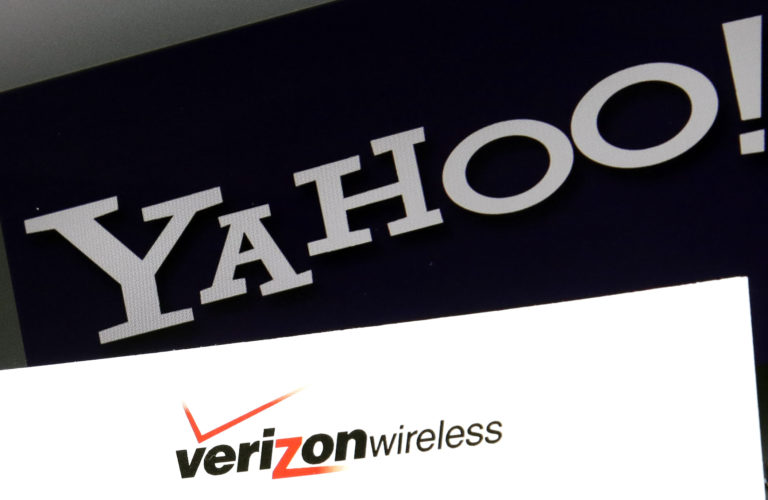 AP PHOTO This July 25, 2016, file photo shows Yahoo and Verizon Wireless logos on a laptop, in North Andover, Mass. Verizon is buying Yahoo in hopes of challenging Google and Facebook in the digital advertising market by combining ad technologies and user profiles from Yahoo and the AOL business it already owns.