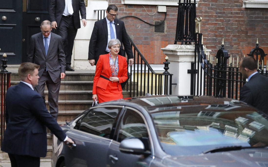 AP PHOTO Britain's Prime Minister Theresa May leaves Conservative party headquarters in London, Friday.