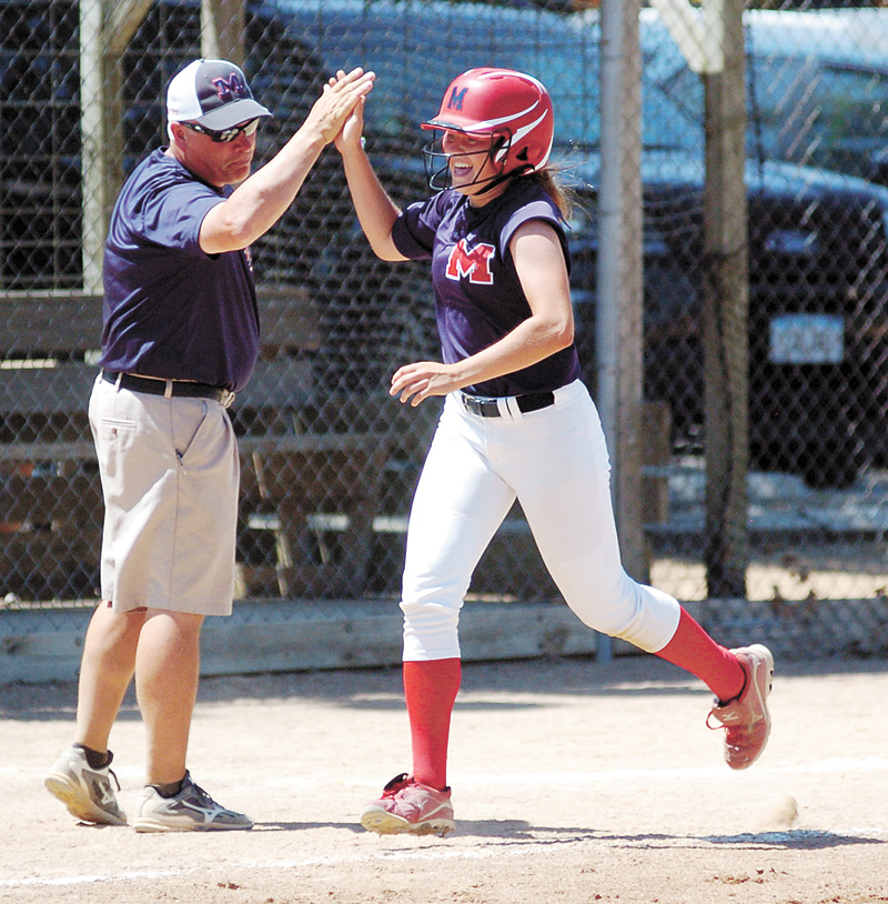 T-R PHOTO BY ROSS THEDE • Marshalltown head coach Jim Palmer, left, congratulates senior Aspen Chadderdon as heads home on her first-career home run, a two-run shot that provided the eventual game-winning margin in the Bobcats' 4-2 victory against Sumner-Fredericksburg on Saturday.