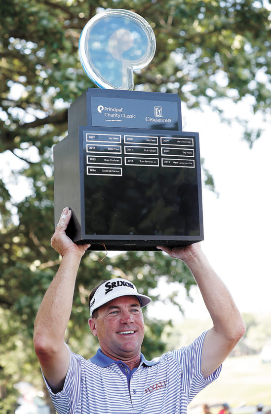 AP PHOTO • Brandt Jobe hoists the trophy after winning the PGA Champions Tour's Principal Charity Classic golf tournament Sunday at the Wakonda Club in Des Moines.