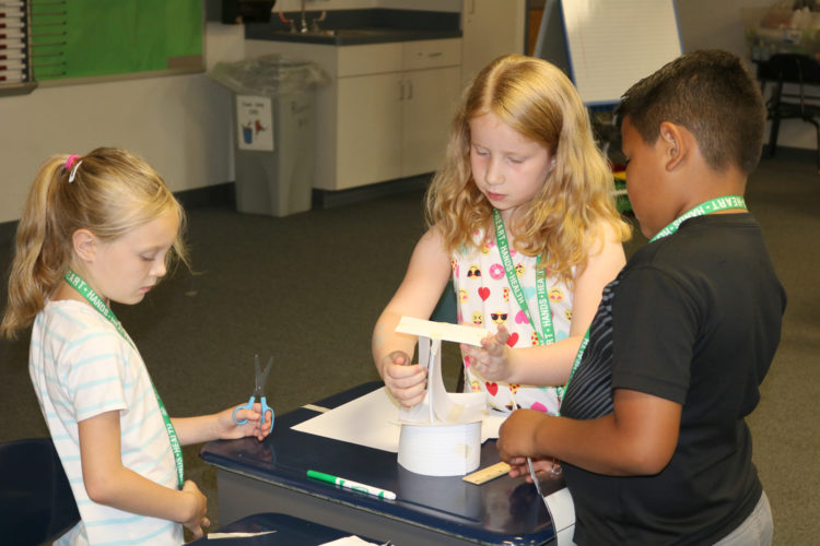 T-R PHOTO BY ADAM SODDERS Building towers with nothing but note-cards and tape was just one of several STEM-based activities Marshalltown area students are doing for the 2017 Summer STEM Camp with ISU Extension and the Marshalltown Business Education Alliance.