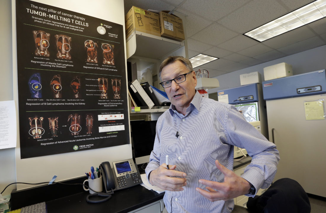 """In this photo taken March 28, 2017, Dr. Stanley Riddell describes how a patient's large tumor rapidly shrank in an immunotherapy study at the Fred Hutchinson Cancer Research Center in Seattle. Riddell's team studies """"living drugs"""" that are genetically engineered from patients' own immune cells to make them better cancer killers.  (AP Photo/Elaine Thompson)"""