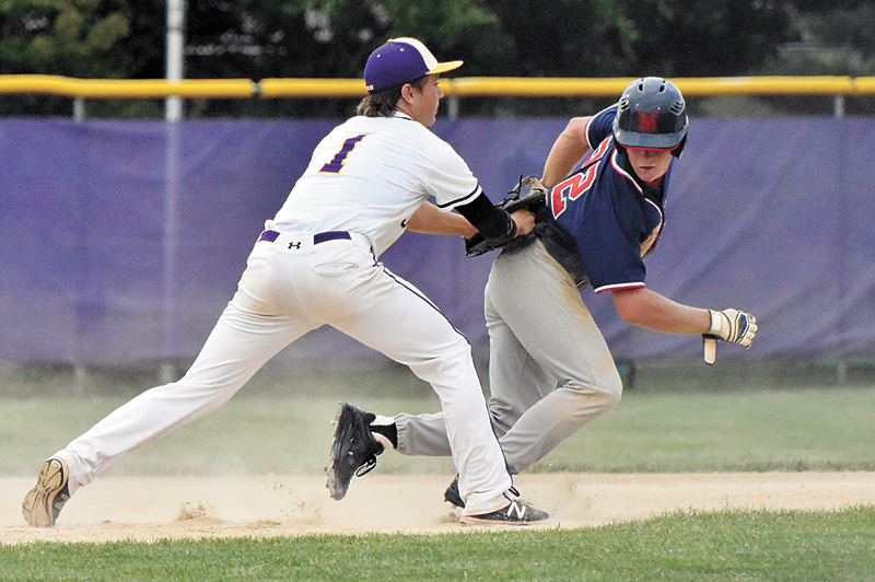 T-R PHOTO BY ANNE VANCE • Marshalltown's Noah DeVenney is tagged out by Johnston's Nathan Buckallew (1) during Monday's CIML Iowa Conference baseball doubleheader at Johnston. Class 4A's top-ranked Dragons won by scores of 17-2 and 6-0.