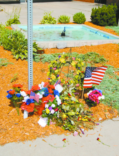 T-R PHOTO BY JEFF HUTTON A makeshift memorial has been established near the intersection of Church and Center streets in downtown Marshalltown. The intersection on Friday was the site of a fatal accident that claimed the life of U.S. Postal Employee Amy Sanders, 34, of Grinnell.