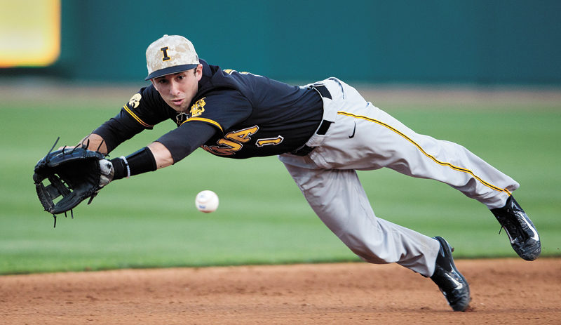 AP FILE PHOTO  University of Iowa shortstop Mason McCoy dives for a ground ball against Nebraska during a Big Ten Conference baseball game April 15 in Lincoln, Neb.