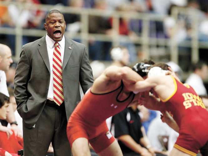 AP FILE PHOTO • In this Jan 9, 2010, file photo, Iowa State's head coach Kevin Jackson, left, directs Iowa State's Dalton Jensen, right, against Maryland's Alex Krom in the 141 pound weight class quarterfinal match at the NWCA National Duals wrestling competition at the UNI-Dome in Cedar Falls. Jackson, the former Iowa State coach, has been hired by USA Wrestling on Wednesday, June 14, 2017, developmental coach for the men's freestyle team.