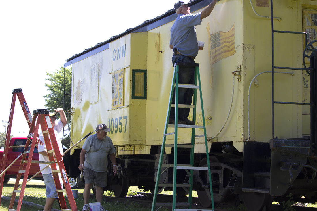 T-R Photo by Mike Burvee  Members of the Marshalltown NARVE (National Association of Retired and Veteran Railway Employees) came out to Mega-10 Park on Thursday to help refurbish the long-standing caboose. It went out of commission about 10. This particular caboose was signed to Dick Reisel (not pictured) for his route from Marshalltown to Mason City.