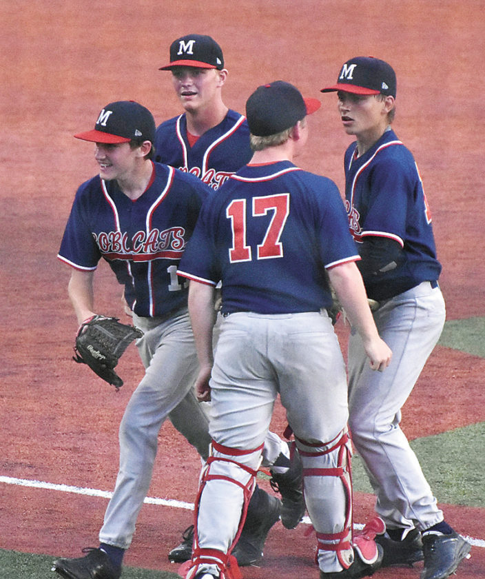 T-R PHOTO BY ANNE VANCE • Members of the Marshalltown baseball team celebrate the Bobcats' 4-3 win in the nightcap of Thursday's cross-CIML doubleheader against Southeast Polk in Pleasant Hill.