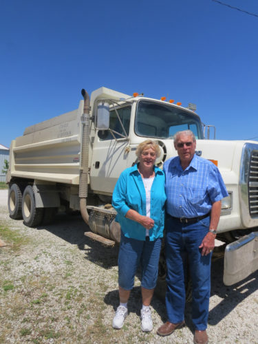 T-R PHOTO BY MARGARET THOMSEN The 2017 Corn Carnival Grand Marshals Judy and Marvin Wendel are pictured by one of their trucks. The couple has been hauling lime and quarry materials in the Gladbrook area for more than 50 years.