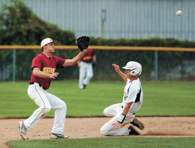 T-R PHOTO BY ROSS THEDE • West Marshall's Cameron Bannister, right, slides safely into second base behind PCM's Noah Henkenius with a stolen base during the third inning of Saturday's title game at the Rose Festival Tournament in State Center. PCM defeated the host Trojans 3-2 to claim its first Rose Festival Tournament crown since 2013.