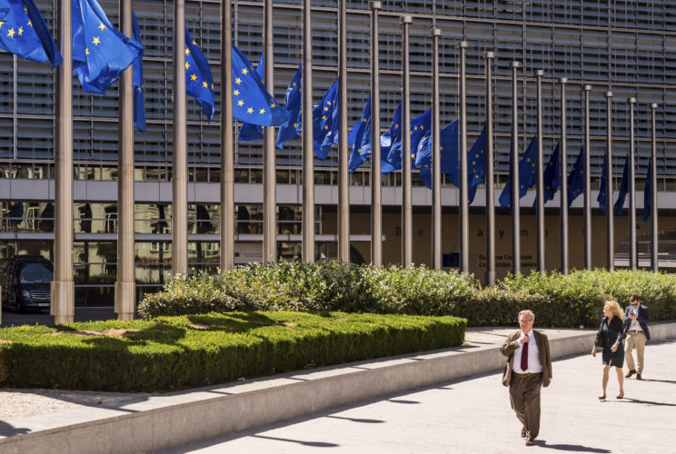AP PHOTO European Union flags fly at half staff in front of EU headquarters in Brussels on Monday. The flags were lowered on Monday to show solidarity for the victims of deadly forest fires in Portugal.